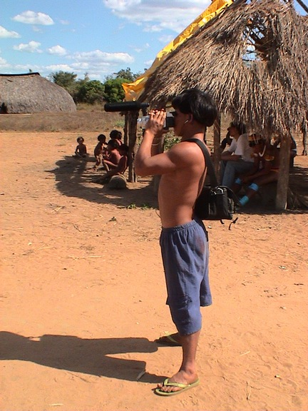 A young Awetí documenting the Tawarawana festival