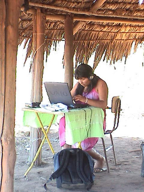 An Awetí co-worker with the community laptop
