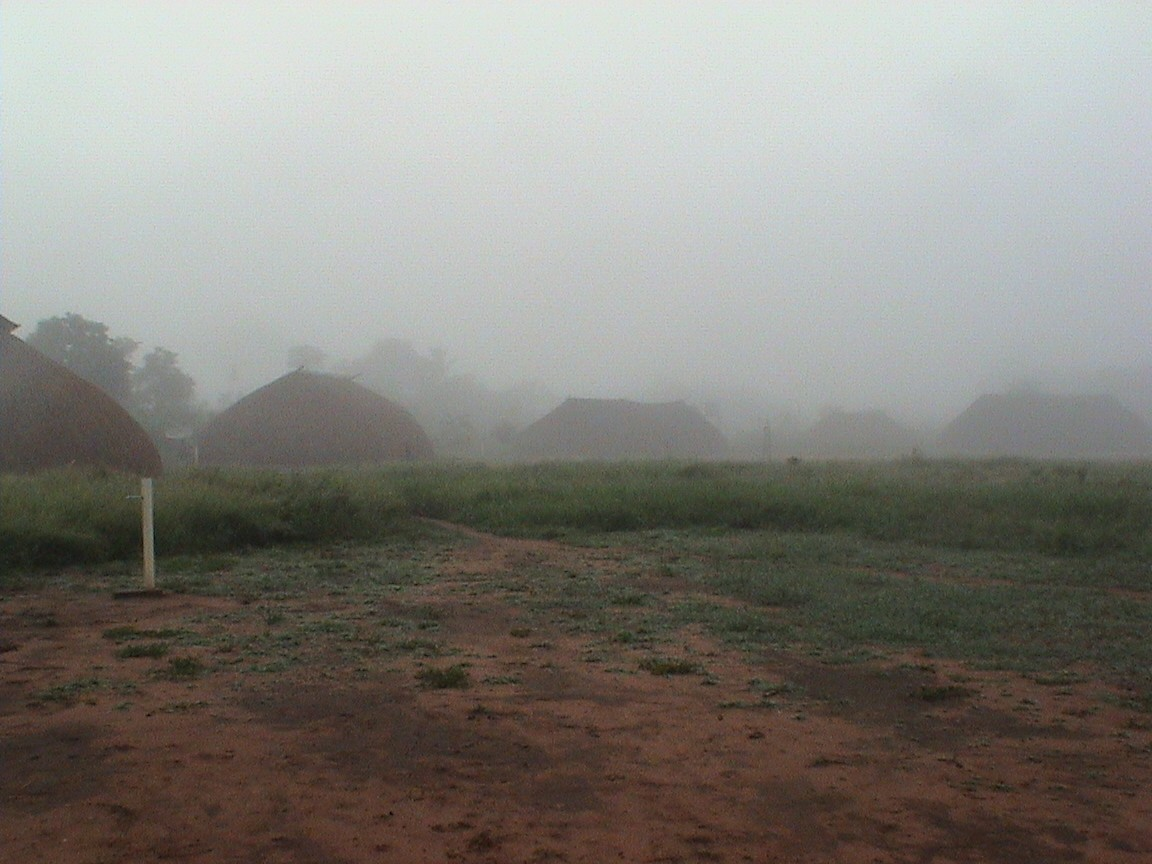 Part of the circle of houses around the central plaza, with early fog during the rainy season